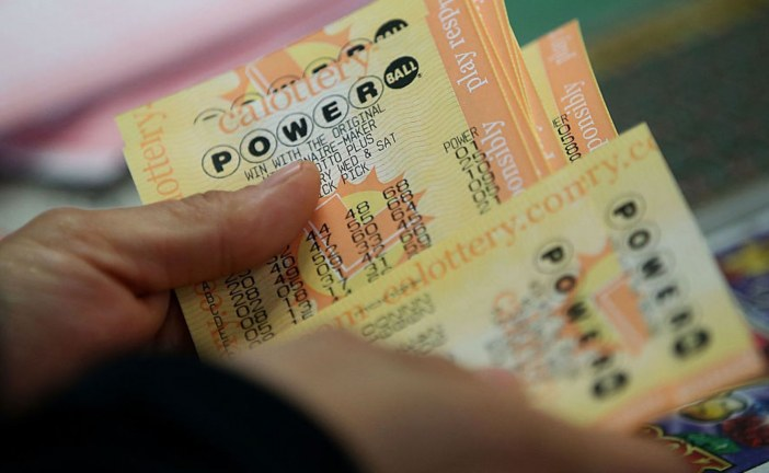 There's a huge tax bill if you hit Powerball or Mega Millions jackpot