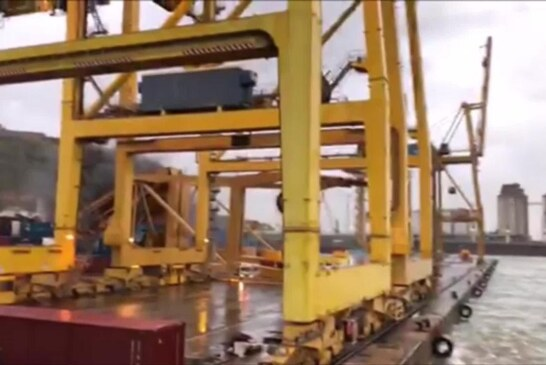 Ferry crashes into crane and causes fire