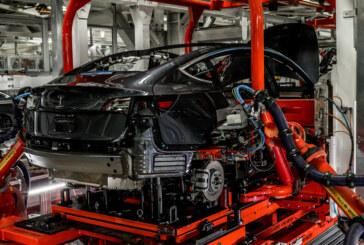 Tesla Reports a Rare Quarterly Profit, Its Biggest Ever